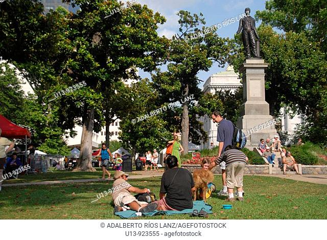 Local people resting on a Friday afternoon at Lafayette Square, Central Business District, New Orleans, Louisiana, USA