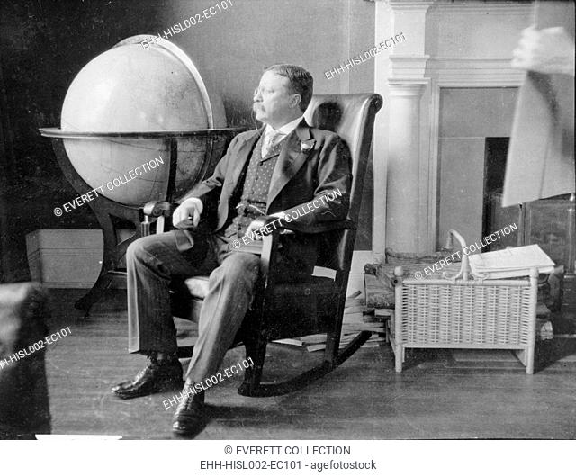 Theodore Roosevelt, at the end of his presidency, seated in rocking chair, by large globe. During Roosevelt's presidency