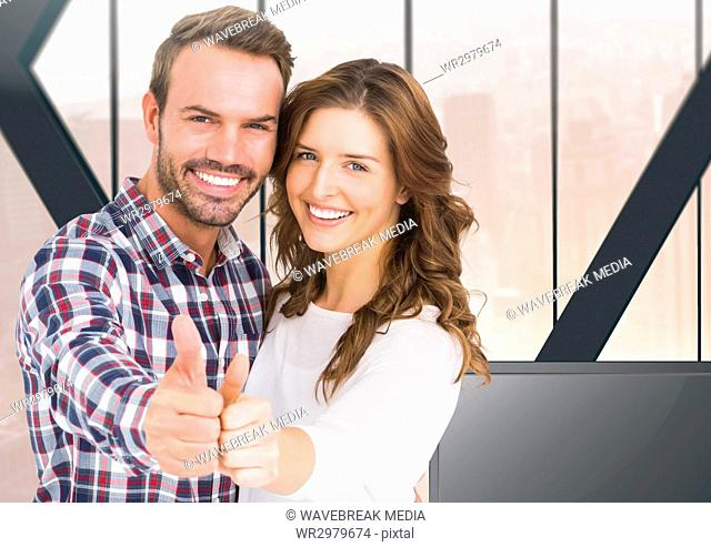 Couple thumbs up at home
