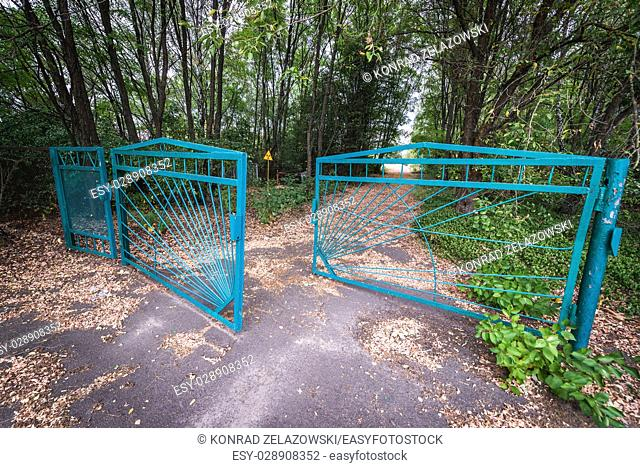 Gate of cemetery in Pripyat ghost city of Chernobyl Nuclear Power Plant Zone of Alienation around nuclear reactor disaster in Ukraine