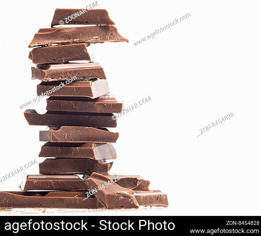 Chocolate blocks stack isolated on white background