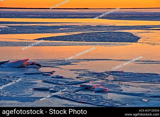 Ice at sunset on frozen Lake Winnipeg Balsam Bay Manitoba Canada