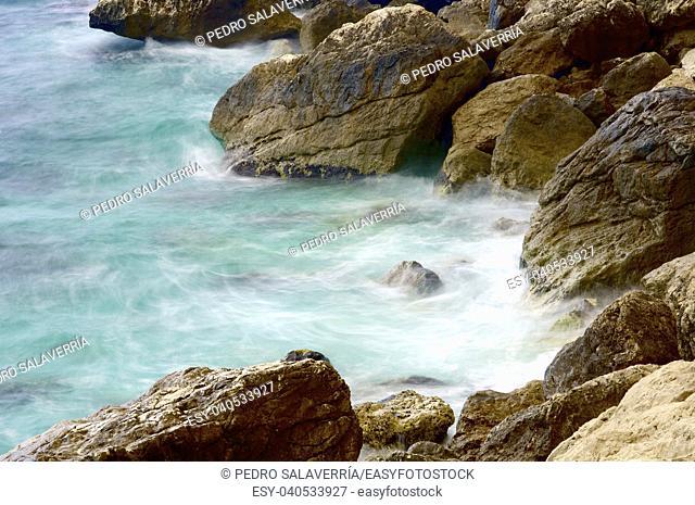 Rocks in water at the Mediterranean coast in Calpe, Alicante, Valencia, Spain