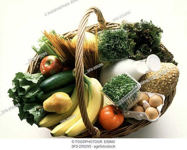 Wicker basket with various foodstuffs