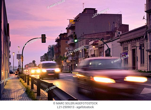 Spain, Catalonia, Barcelona province, Maresme, Vilassar de Mar, N-II road, Road traffic at dusk