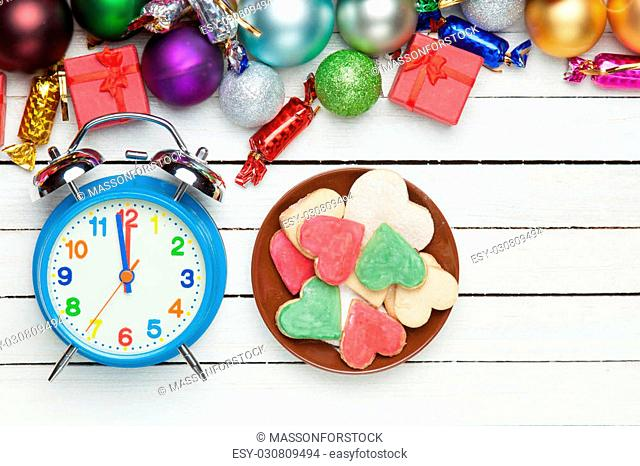 Cookies with alarm clock and chritmas gifts