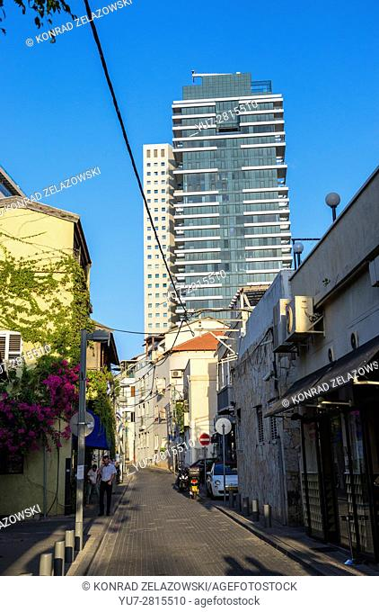 Shalom Shabazi street in Neve Tzedek neighborhood, Tel Aviv city, Israel. 1 Rothschild Boulevard Tower on background