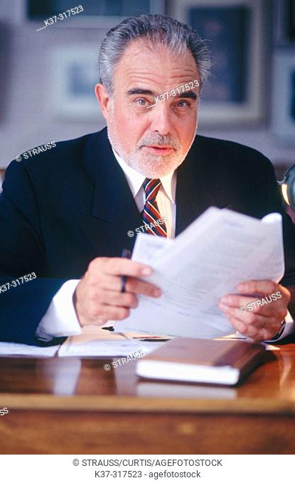Mature executive businessman at desk
