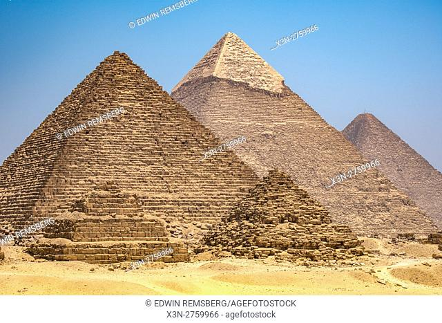 Cairo, Egypt The three Great pyramids of Giza against a clear blue sky. From left to right stands the Pyramid of Mekaure (smallest of the three)