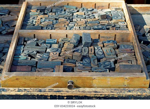 A tray of carved wooden letters Stock Photos and Images
