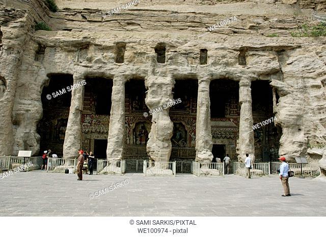 Carved pillars at the entrance to the Yungang Grottoes, Datong, Shanxi, China