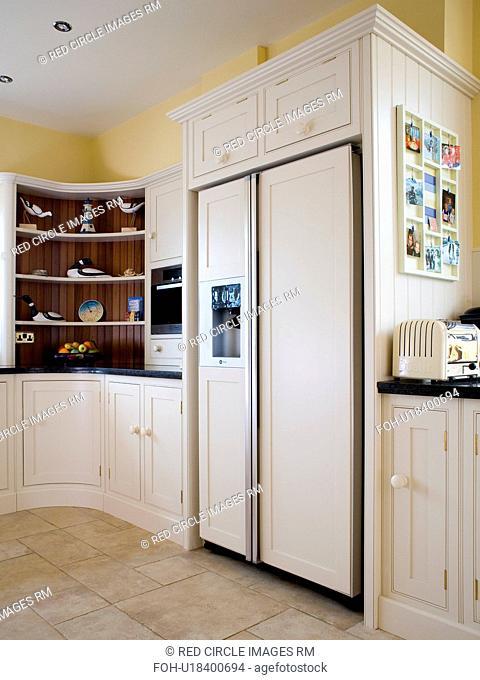 Large American-style fridge-freezer in modern cream kitchen