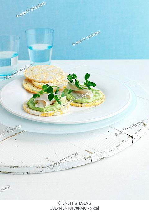 Plate of crackers with cheese and herbs