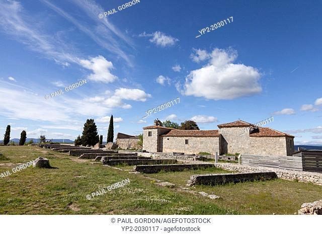 Hermitage built on the ruins of the Roman city of Clunia in Burgos Province - Castile and León, Spain. Looking north from the forum towards House Number 1