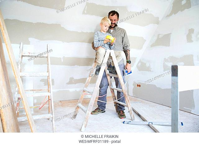 Father and son working on loft conversion