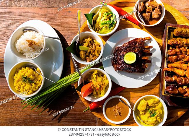 Traditional balinese sea food with satay and curry in Bali, Indonesia