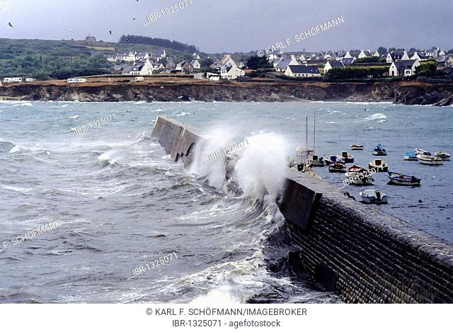 High waves crashing over the harbor wall, stormy seas on the Brittany coast, hurricane, Finistere, Brittany, France, Europe