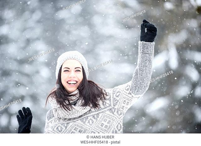 Young woman having fun in snow