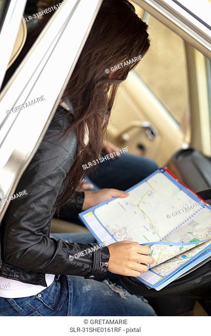 Girl looking in map
