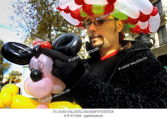 Street artist, making balloon figueres  La Rambla  Spain  Europe