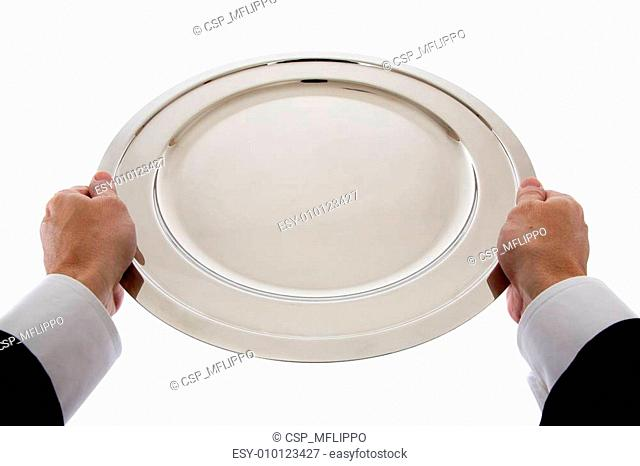 An empty tray held by service personnel
