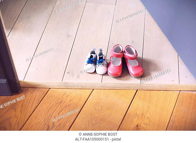 Children's shoes side by side on floor