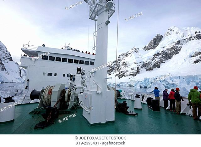 passengers on board ship passing through the lemaire channel antarctica