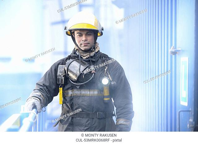 Firefighter standing on platform