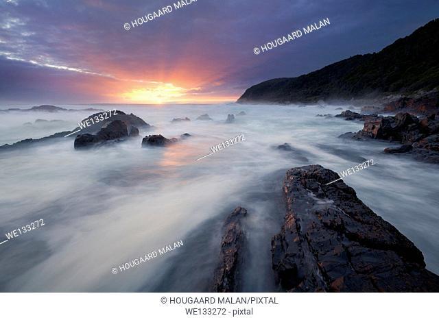 Landscape photo of a colourful sunset on the Tsitsikamma coastline. Tsitsikamma National Park, Western Cape, South Africa