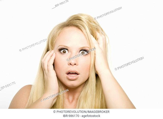 Young blonde woman, shocked expression