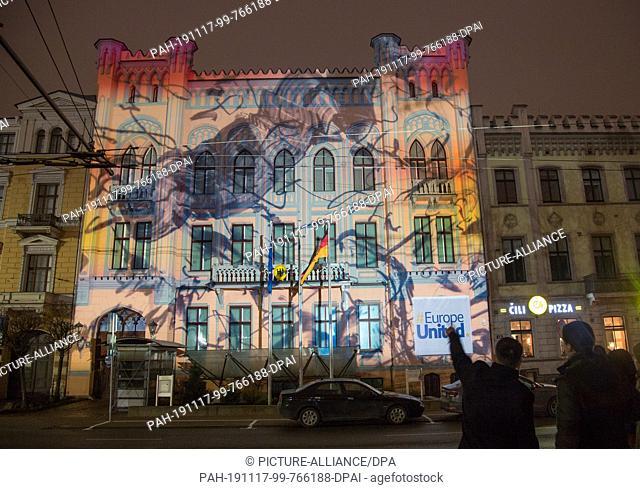 16 November 2019, Latvia, Riga: A video projection of the Berlin artist Robert Seidel at the building of the German Embassy in Riga