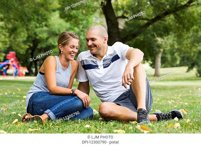 A married couple spending quality time together in a park; Edmonton, Alberta, Canada