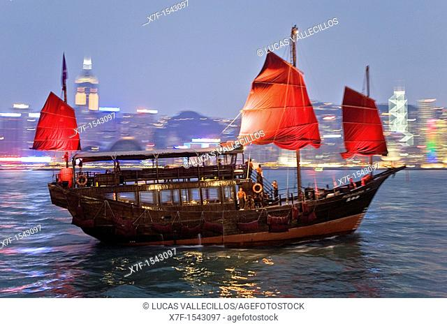 Traditional Sailing boat in Victoria Harbour with City Skyline in the Background,Hong Kong, China