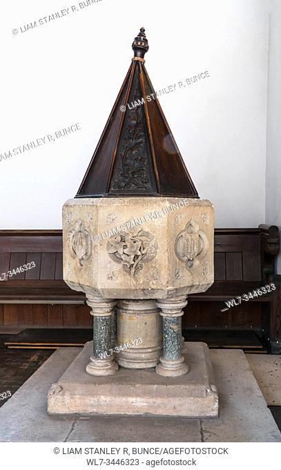 Font dating from around 1840 as it belonged to the original Chapel, it stands on four marble pillars, St Catherine church Hoarwithy Herefordshire UK