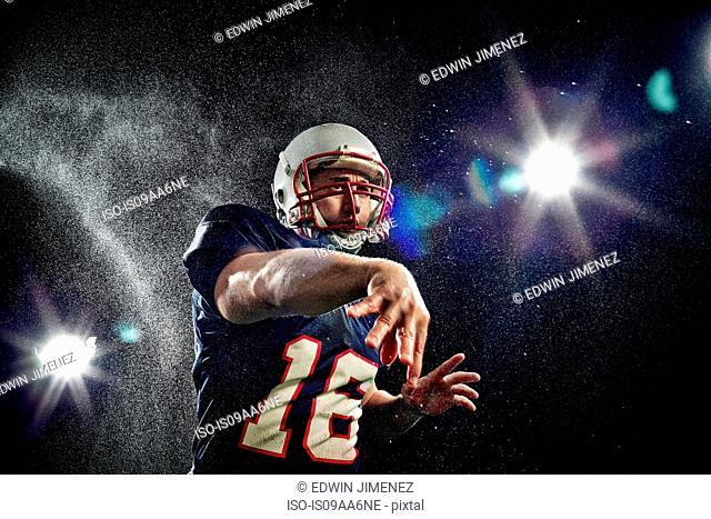 American footballer throwing