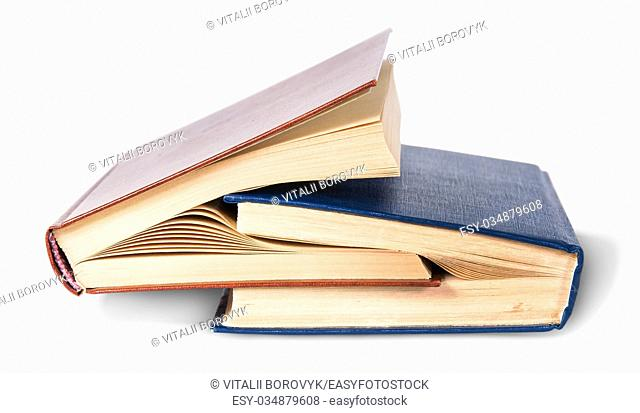 Two old books nested isolated on white background