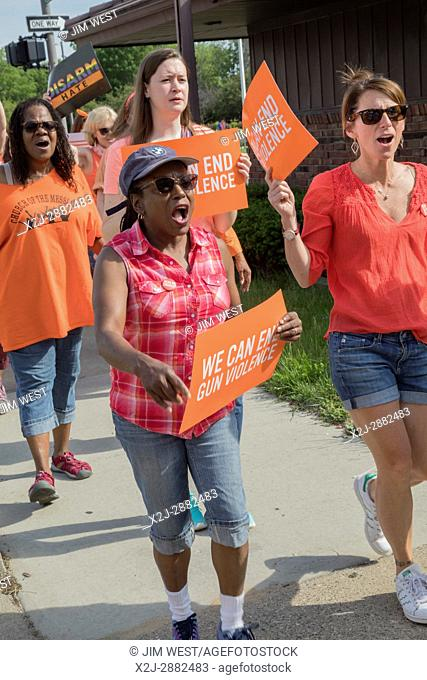 Detroit, Michigan USA - 3 June 2017 - Members of Moms Demand Action march to end gun violence. Participants chose orange as their color