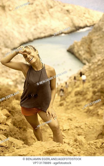 young woman at Seitan Limania Beach, Crete, Greece