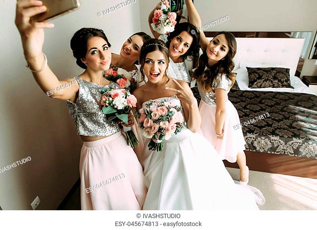 Bride and bridesmaids are taking a selfie