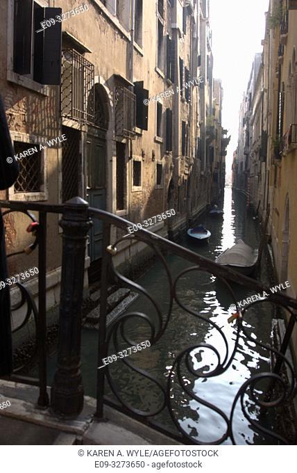 narrow canal with bridge, Venice, Italy