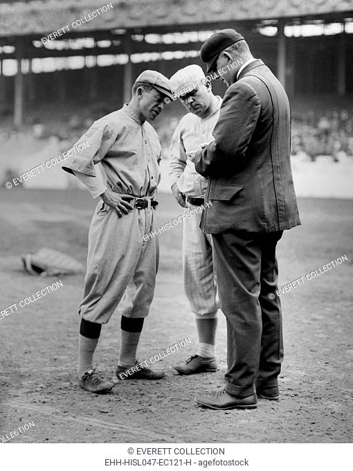 Managers John McGraw, and Miller Huggins, with umpire William T. Brennan, 1913. At the timer, McGraw managed the NY Giants and Huggins managed the Baltimore...