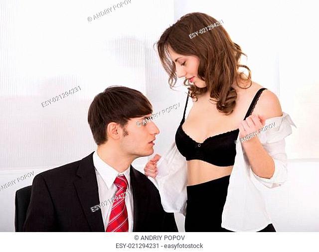 Businesswoman Undressing Self To Seduce Boss In Office