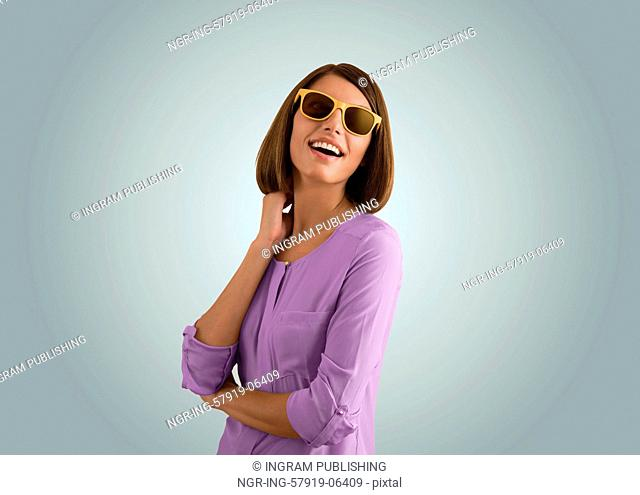 Portrait of a beautiful fashion girl with sunglasses expressing positivity