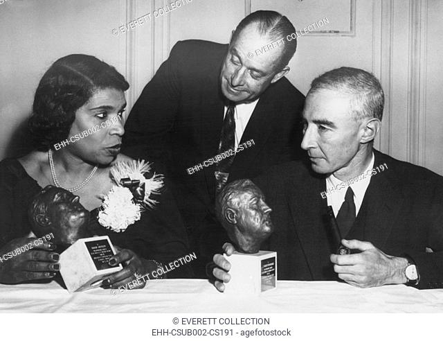 Concert singer Marian Anderson and physicist Dr. J. Robert Oppenheimer honored. Both were cited for 'distinguished service to the principles of American...