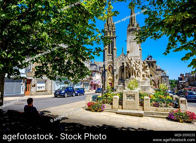 Notre-Dame de la Ferté-Macé, Lower Normandy, France with the town's war memorial in the foreground