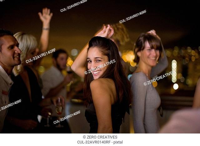 Woman dancing at party at night