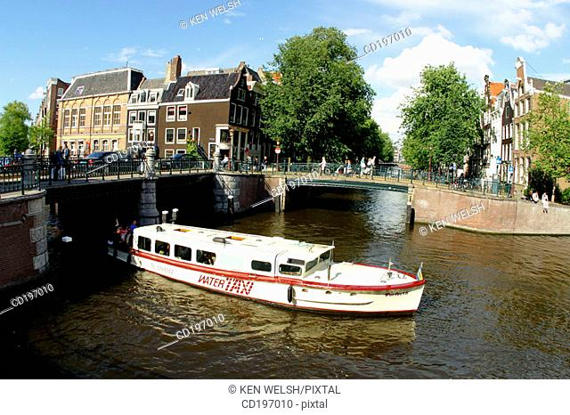 Water-taxi on canal. Amsterdam. Holland
