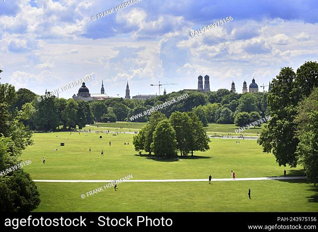 Public life in times of the coronavirus pandemic in the English Garden in Munich. View of the Frauenkirche and Theatinerkirche, city, city, skyline