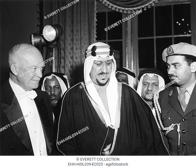 President Eisenhower with Saudi Arabia King, Saud ibn abd al-Aziz Al-Saud and his interpreter. They are at a dinner in the King's honor at the Mayflower Hotel