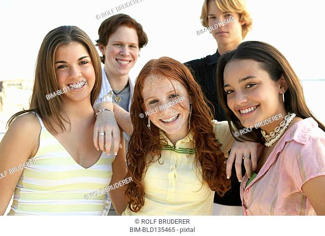 Teenagers standing together on beach